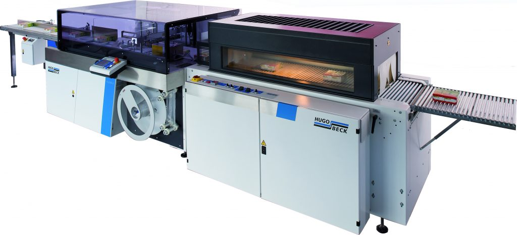 Automatyczna maszyna pakująca w folię termozgrzewalną Hugo Beck wraz z tunelem